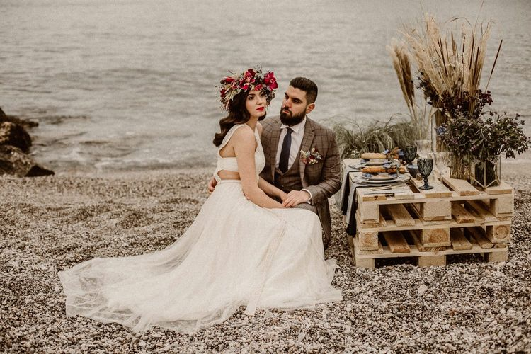 picnic at beach elopement  with wooden pallets