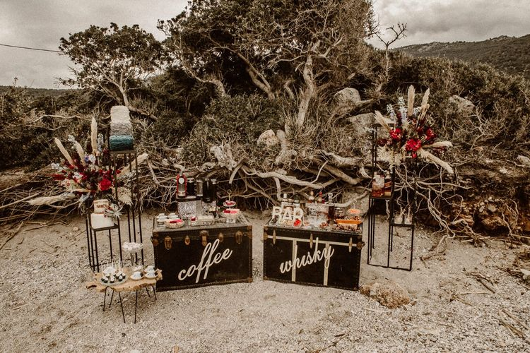 Coffee and whiskey stations on the beach at intimate elopement