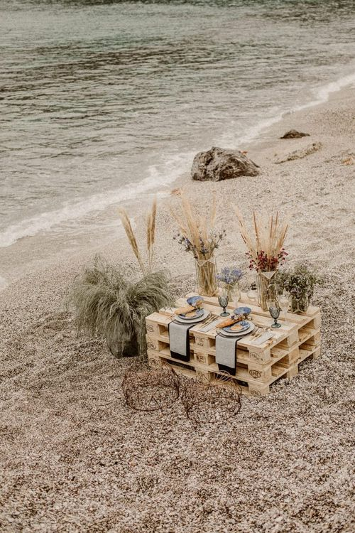 Sweetheart table on the sand at beach elopement
