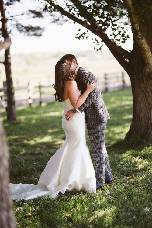 First Look with Bride in Fishtail Wedding Dress and Groom in Brown Check Suit