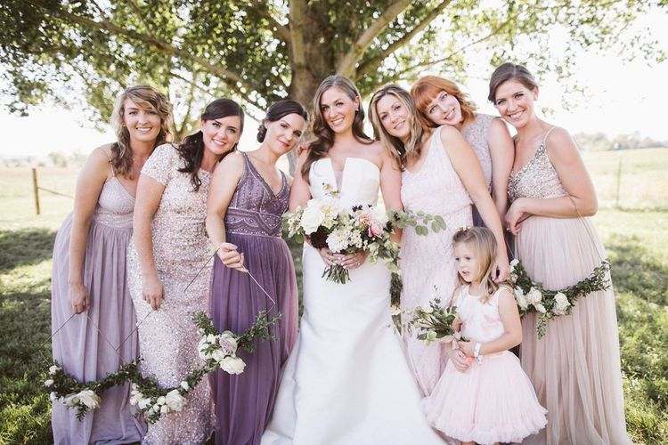 Bridal Party Portrait with Bridesmaids in Pink, Lilac and Purple Dresses and Geometric Hoop Bouquets