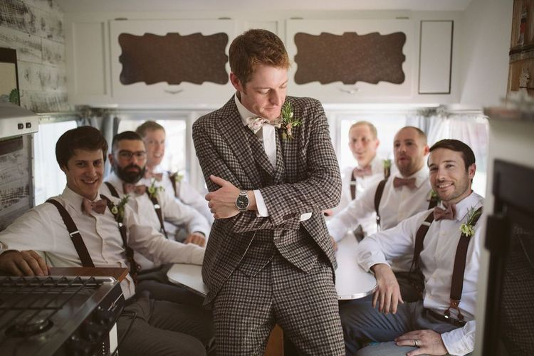 Groom in Brown Check Suit with Groomsmen in Braces and Bow Ties