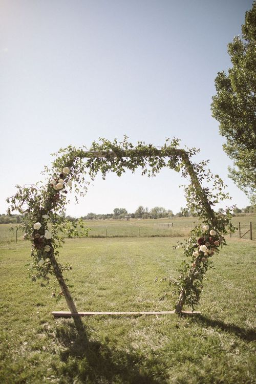 Hexagonal Arch Decorated with Wedding Flowers