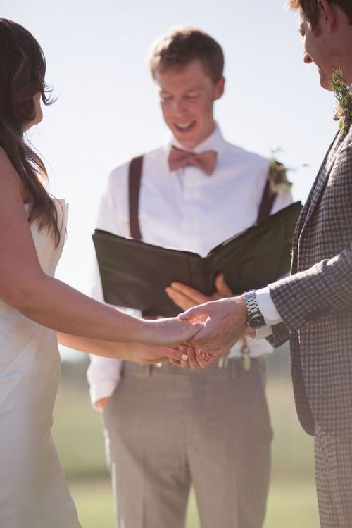 Outdoor Wedding Ceremony with Bride and Groom Holding Hands