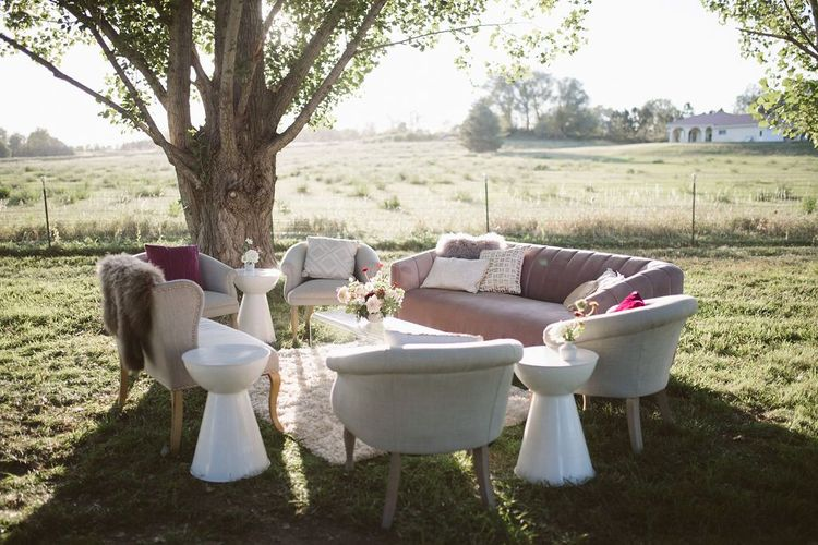 Outdoor Seating Area with Ornate Sofas and Chairs