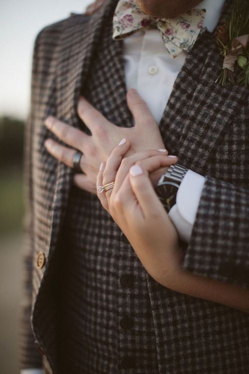 Bride and Groom Holding Hands Showing Off their Wedding Bands