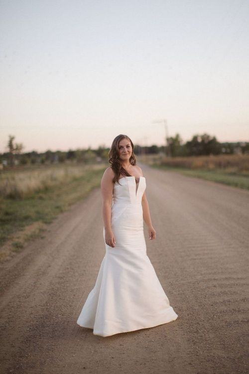 Beautiful Bride in Off the Shoulder Wedding Dress with Fishtail Skirt