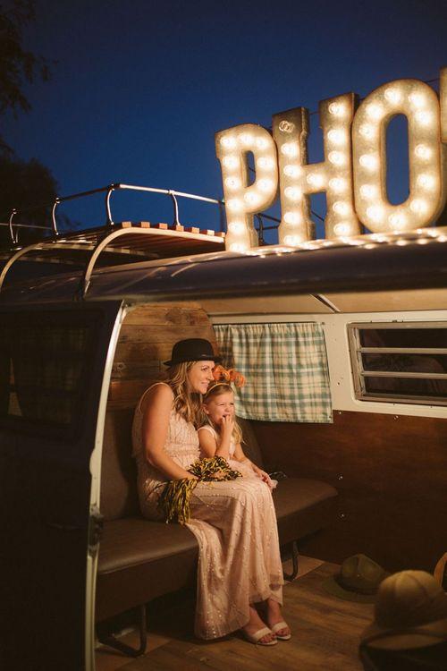 Wedding Guests Enjoying a Camper Van Photo Booth