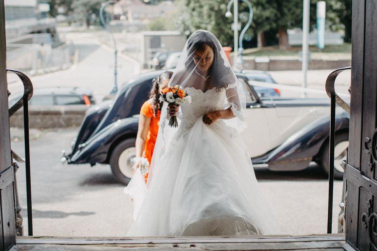 Church bridal entrance in an Amanda Wyatt wedding dress