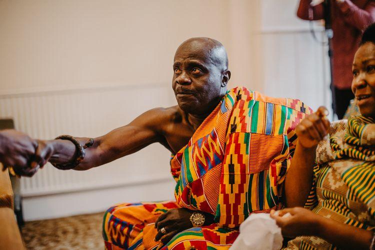 Wedding guest in vibrant African wedding dress