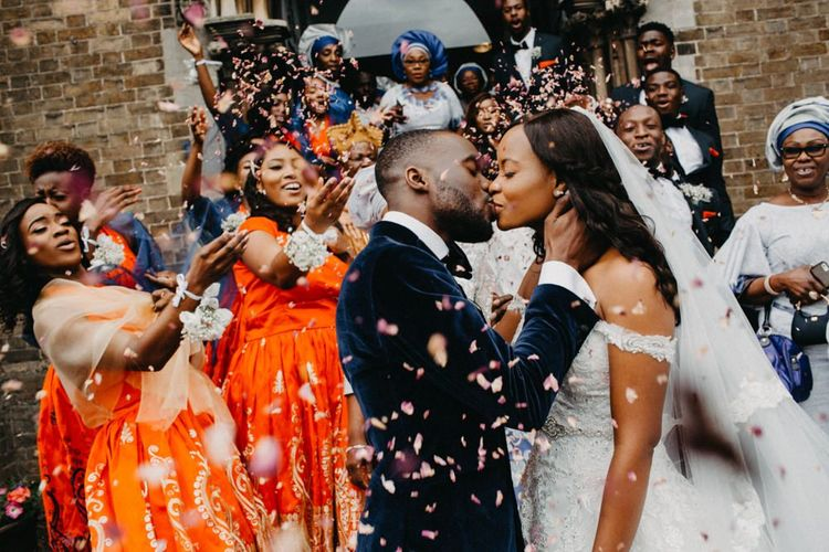 confetti moment with bride and groom kissing