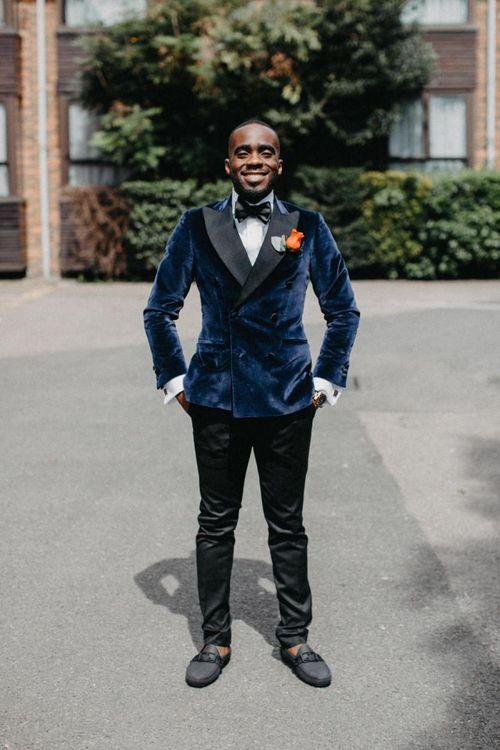 Stylish groom in blue velvet tuxedo jacket