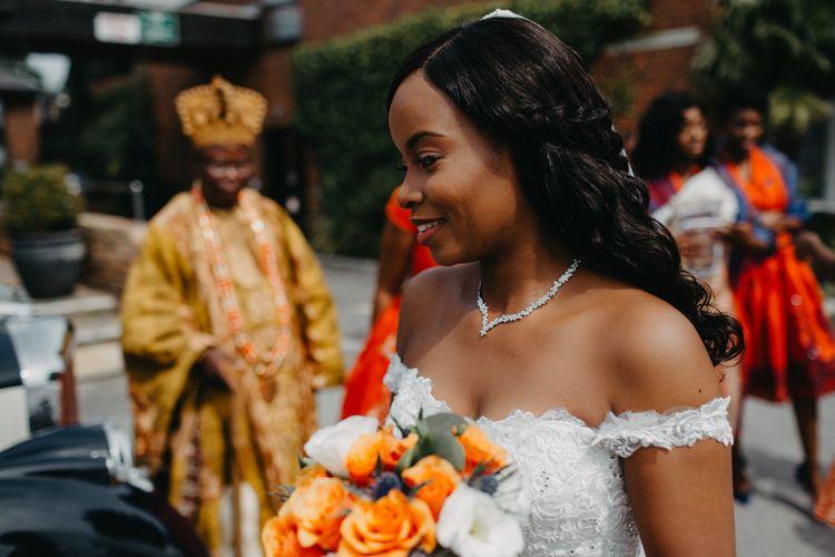 Beautiful bride in off the shoulder Amanda Wyatt wedding dress