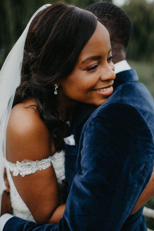 Bride leaning on her husbands shoulder