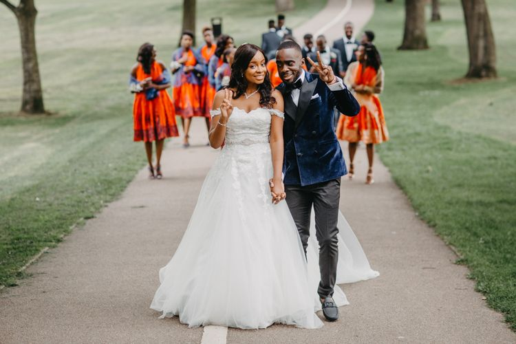 Stylish bride and groom in Amanda Wyatt wedding dress and navy tuxedo jacket