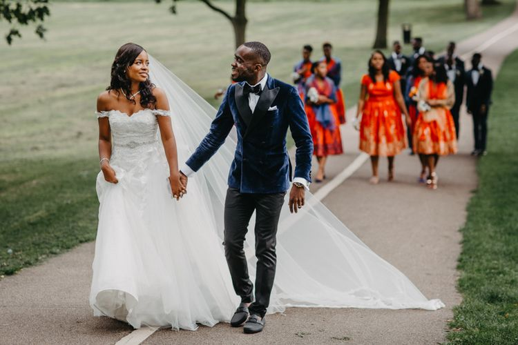 Stylish bride and groom at African wedding