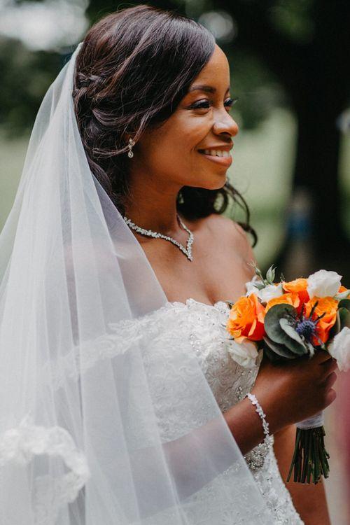 Beautiful black bride in off the shoulder wedding dress