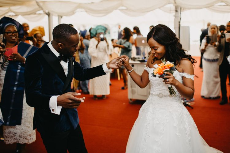Bride and groom dancing at their African wedding reception