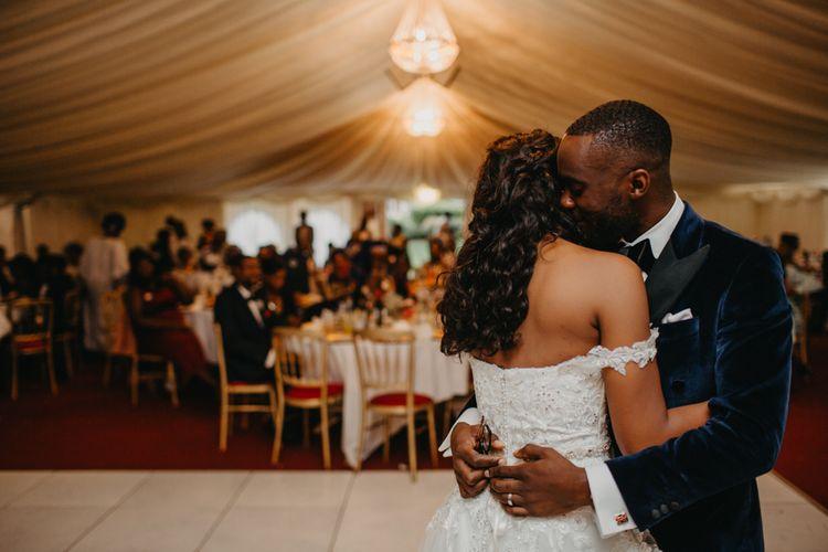Groom embracing his bride on the dance floor