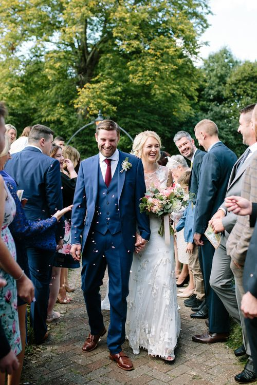 Confetti Moment | Bride in Claire Pettibone Whitney Bridal Gown with Cape | Groom in French Connection Navy Suit | DIY Country Wedding at Warborne Farm, Lymington | Camilla Arnhold Photography