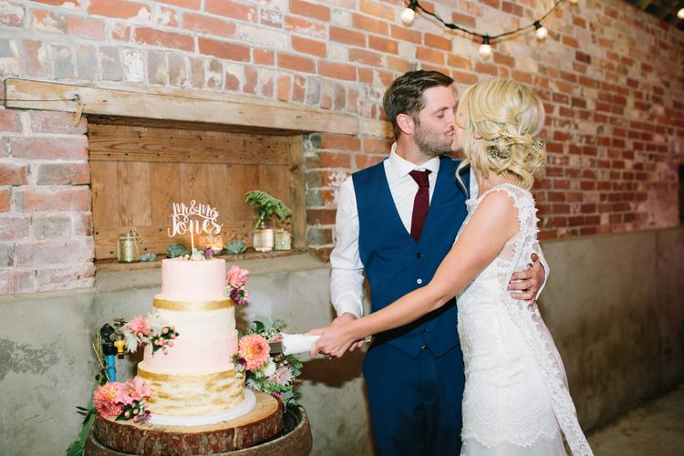 Cutting the Cake | Bride in Claire Pettibone Whitney Bridal Gown with Cape | Groom in French Connection Navy Suit | DIY Country Wedding at Warborne Farm, Lymington | Camilla Arnhold Photography