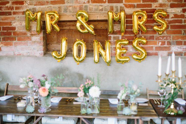 Gold Foil Balloons | Top Table Wedding Decor | DIY Country Wedding at Warborne Farm, Lymington | Camilla Arnhold Photography