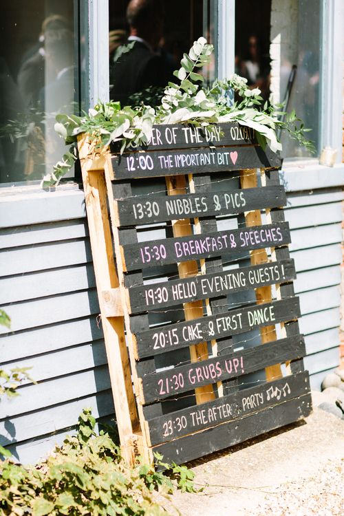 Wooden Palette Order of the Day Wedding Sign | DIY Country Wedding at Warborne Farm, Lymington | Camilla Arnhold Photography