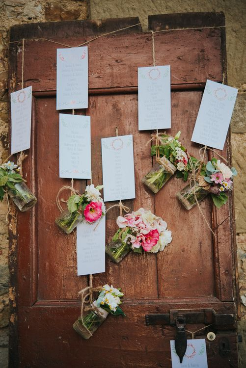 Rustic Door Table Plan with Flowers | Wedding Decor | Stylish Pink Wedding at Terzo di Danciano, Tuscany, Italy | Lucrezia Senserini Photography | Film by Righi Photography