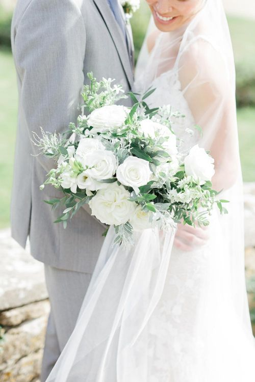 White Wedding Flowers For Wedding With Blue Bridesmaid Dresses