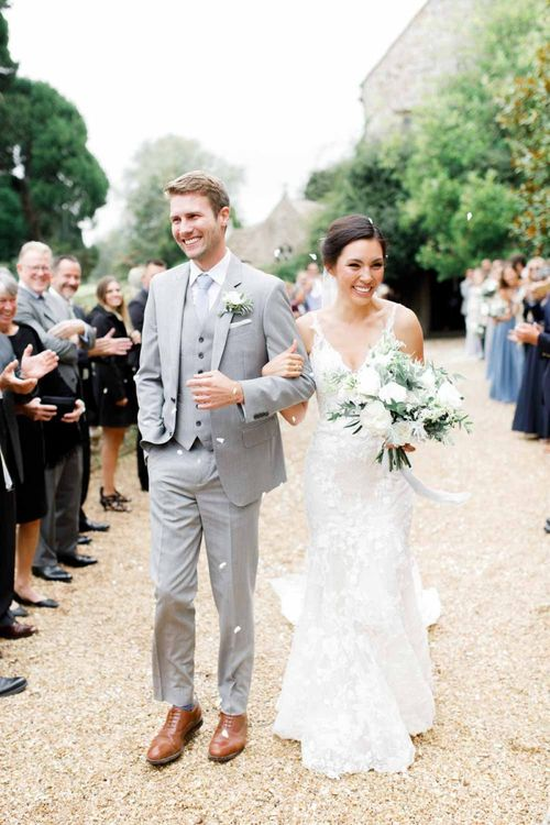 Groom In Pale Grey Suit As Bride Carried Wedding Bouquet