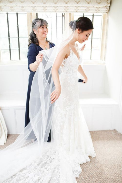 Bride Wears Lace Wedding Dress In Fit And Flare Shape