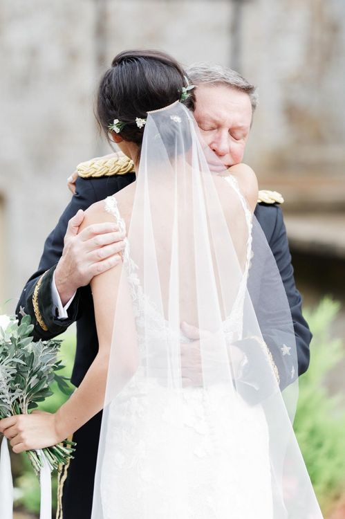 Bride Embraces Father Before Ceremony
