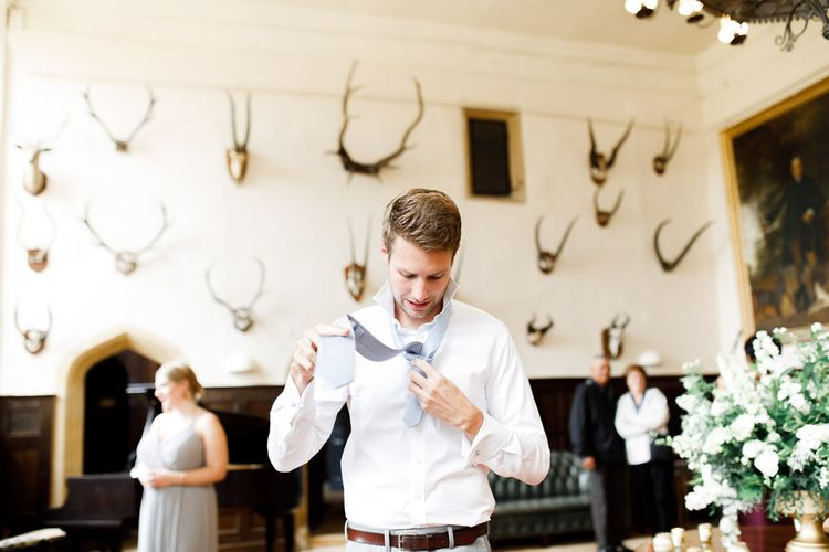 Groom Gets Ready At Wedding Venue