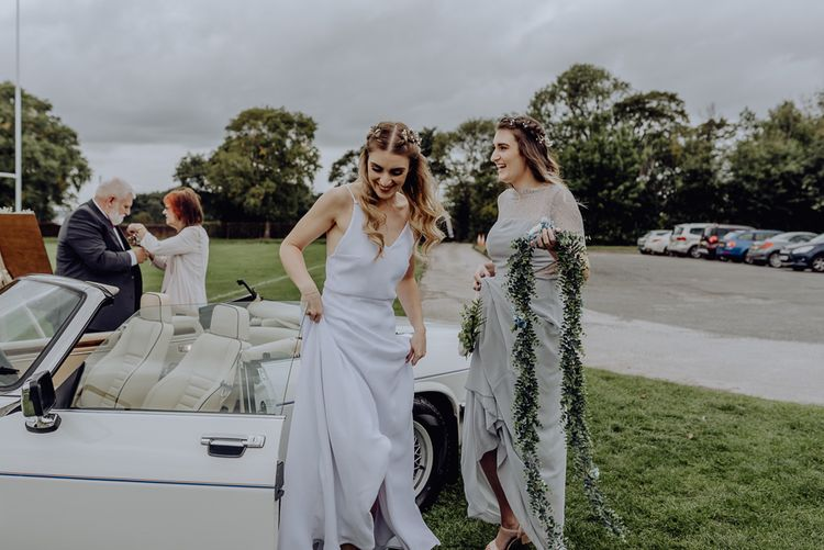 Bride in Slip Wedding Dress Arriving at Wedding Blessing