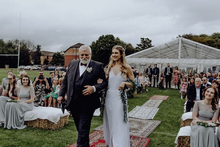 Outdoor Wedding Blessing Ceremony with Bride in Slip Wedding Dress walking Down the Aisle