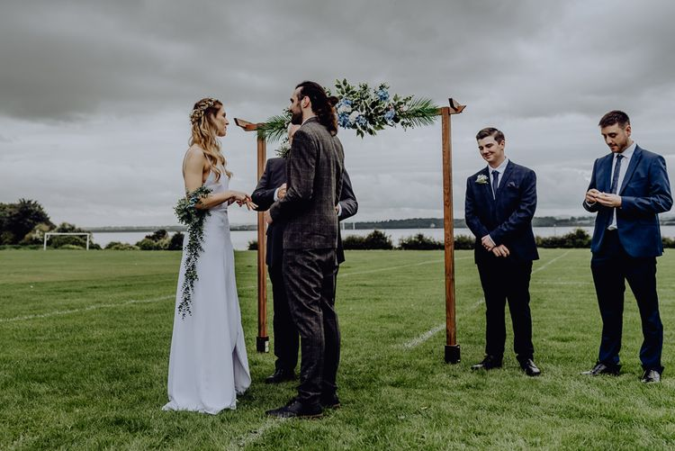 Bride and Groom Standing at the Altar of Their Outdoor Wedding Blessing