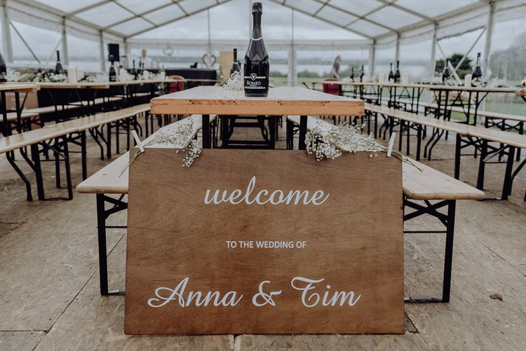 DIY Wooden Welcome Sign with White Calligraphy