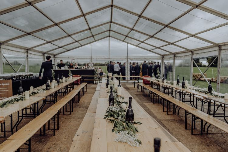 Trestle Tables Inside Glass Marquee Wedding Reception