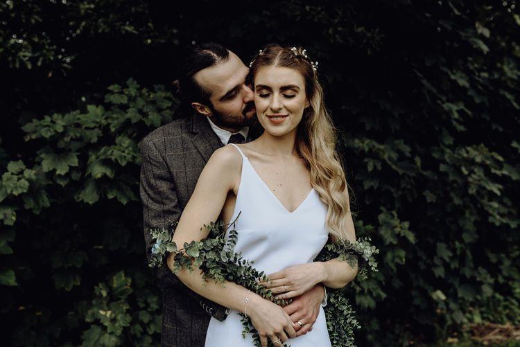 Groom in Bride Check suit Hugging Bride in Spaghetti Strap Wedding Dress
