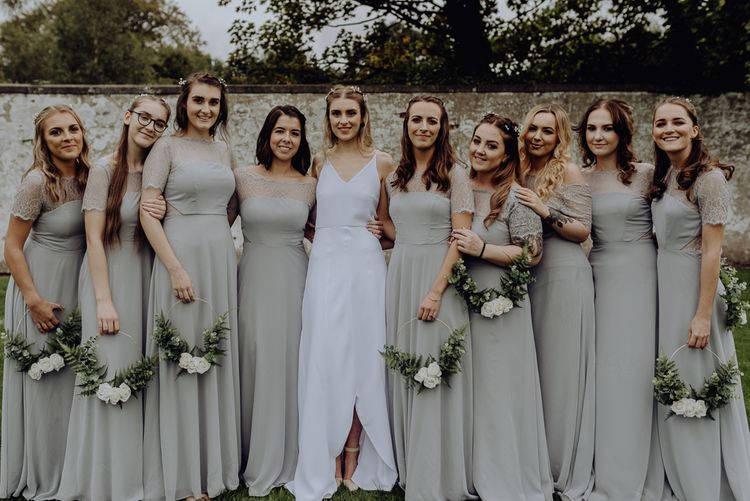 Large Bridal Party with Bridesmaids in Grey Dresses Holding DIY Flower Hoops and Bride in  Slip Wedding Dress