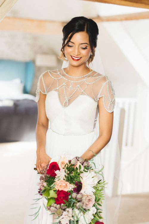 Catherine Deane Wedding Dress with Sweetheart Neckline and Opaque Capped Sleeve with Beading Detail