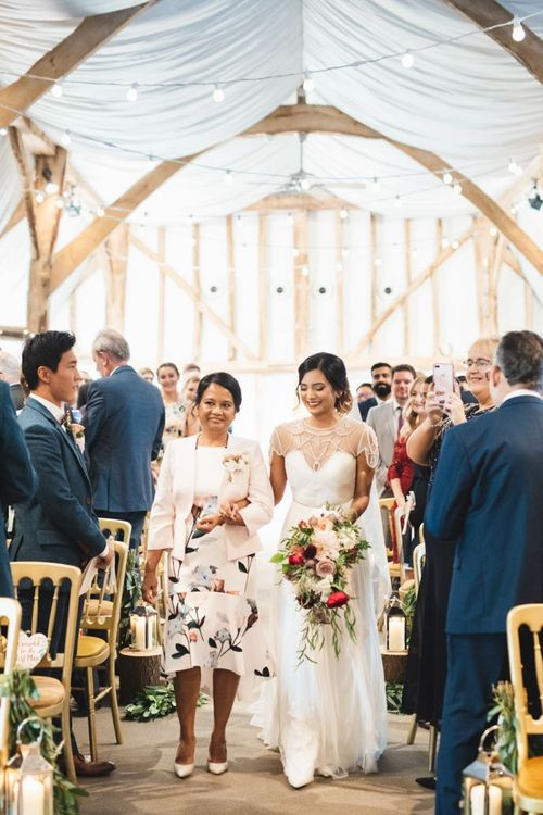 Mother of the Bride Walking Down the Aisle with Daughter in Catherine Deane Brides Dress