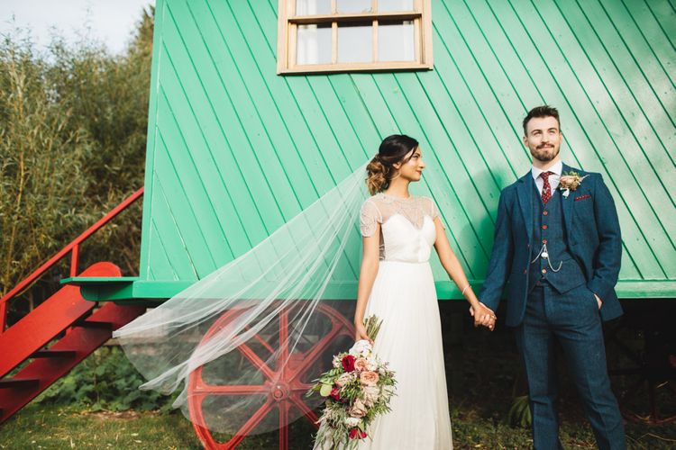 Bride and Groom with Veil and Caravan
