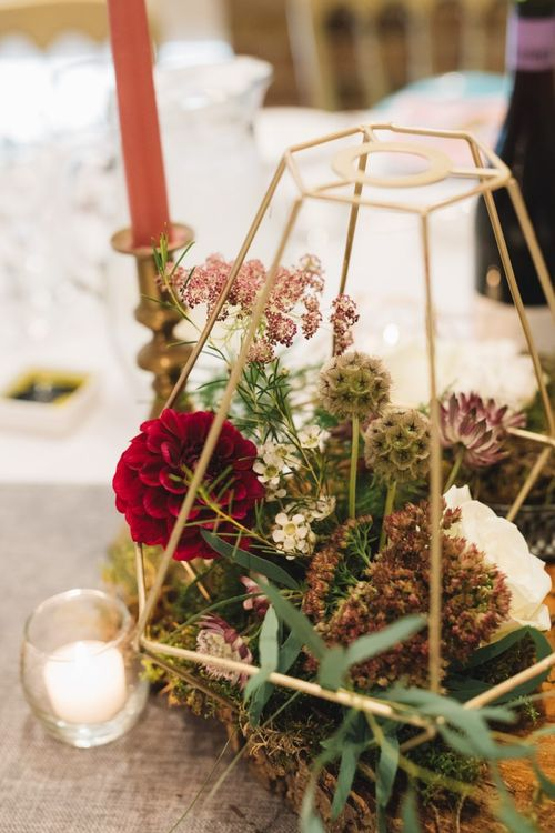 Geometric Gold Centre Pieces with Red Flowers