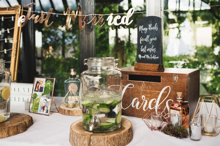 Wooden Card Box on Table with Drinks Dispenser and Just Married Bunting