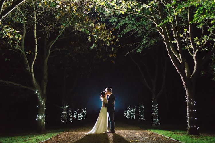 Evening Wedding with Fairylights on Trees