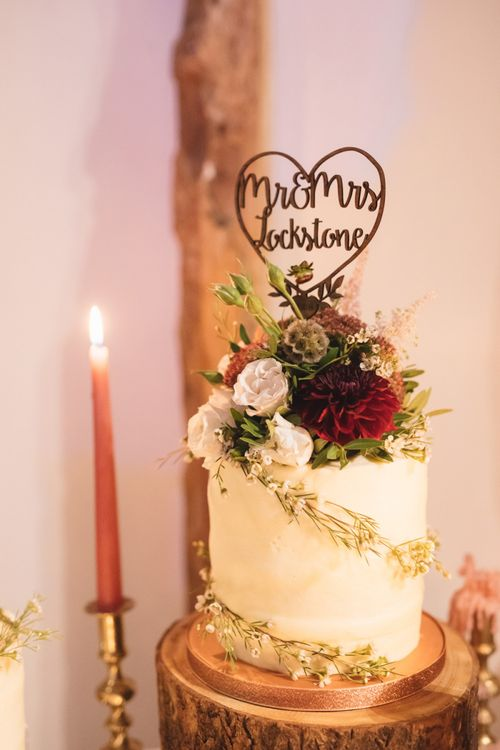 Wedding Cake Topped with Flowers and Wooden Personalised Cake Topper