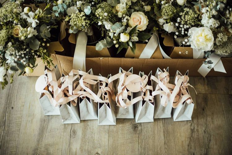 Bridesmaid gift bags with wedding flowers