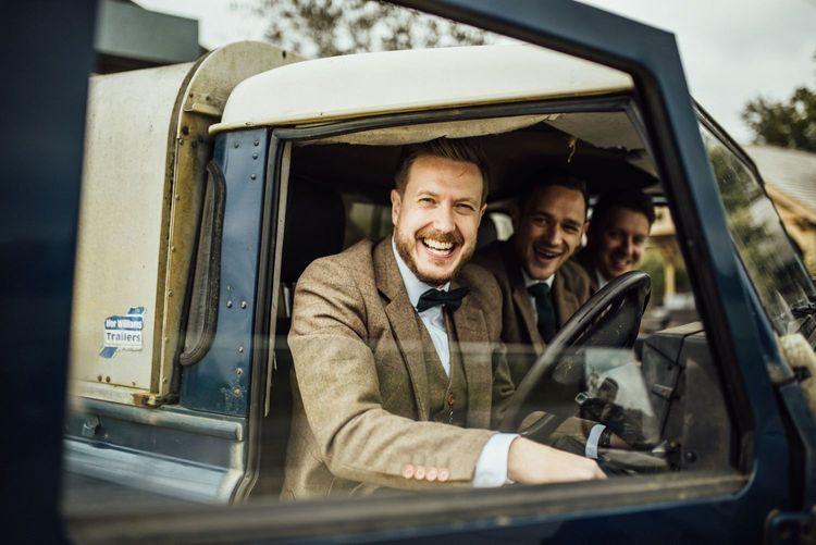 Groom and groomsmen in wedding car on arrival
