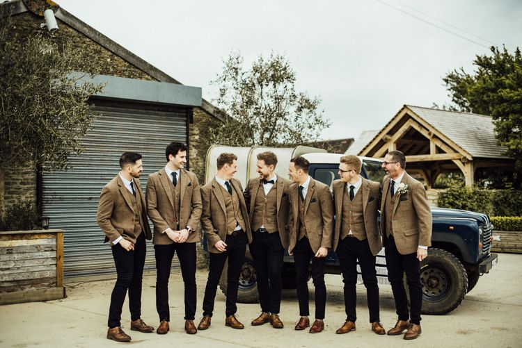Groom and groomsmen in matching tweed suits